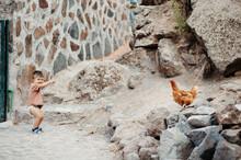 Hen And Boy In Farmyard