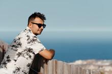 Man In Sunglasses Against Seascape.