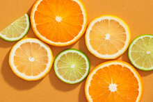Different Citrus Fruits With Leaves As Background