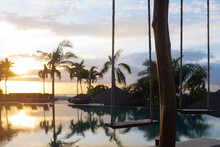 Tropical Pool At Sunset