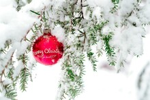 Vintage Christmas Ornament Hanging From A Snow Covered Tree