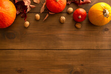 Pumpkins On A Wooden Background Flat Lay