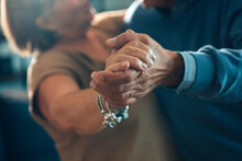 Senior Couple Dancing Hand In Hand - Elderly Taking Tango Course