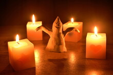 White Clay Ghost Haunted And Light Candle In Halloween Night