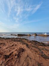 Vertical Shot Of Prince Edward Island Waves Crashing Up On Old Building Remnants