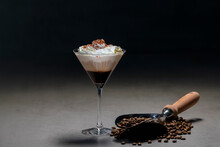 Roasted Coffee Beans And Cocktail Glass With Yummy Cappuccino With Cream