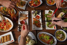 Eating Assorted Colorful Spicy Thai Food With Chopstick