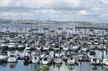Fishing Boats In The Harbour At Brixham On The South Coast Of Devon In The Torbay District.