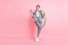 Full Size Photo Of Sportive Blond Millennial Lady Stand Do Excercise Wear Jeans Jacket Visor Isolated On Pink Color Background