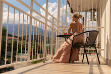 The Girl Sits On The Balcony Of The Mountains And The Blue Sky On The Background Of Beauty Balcony Happy, Adult Outdoor Relax Beauty Sunny, Casual Rich City Holiday, Romantic Hotel