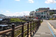 Long Sidewalk Along The Coast And Cityscape In Jeju Island