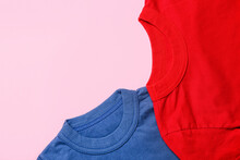 Two T-shirts On Pink Background, Closeup