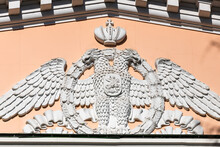 Moscow, Russia - October 13, 2021: Sculpture Of The Coat Of Arms Of The Russian Federation, A Two-headed Eagle On A Soviet Building On Kotelnicheskaya Embankment.