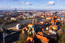 Scenic View From Drone Of Gothic Buildings Of Cathedral Of St. John Baptist And Collegiate Church Of Holy Cross And St. Bartholomew On Ostrow Tumski On Sunny Day, Wroclaw, Poland..
