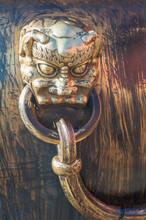 The Bronze Handle Of The Water Vat In Forbidden City