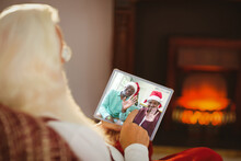 Santa Claus Making Christmas Tablet Video Call With Waving African American Senior Couple