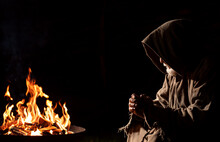 Old Medieval Man Prays By The Campfire