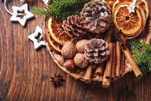 Dry Orange, Star Anise, Cinnamon, Pine Cones And Fir Tree In Rustic Plate On Wooden Table. Homemade Medley Idea For Christmas Mood And Aroma. Eco Friendly Christmas With Homemade Natural Decorations.