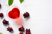 Roselle Juice On Wooden Background, Herbal Organic Tea For Good Healthy