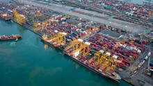 Aerial High Angle View Of Container Cargo Ship And Shipping Port In The Export And Import Industry Business Services And Logistics International Goods In Urban City. Shipping To The Harbor By Crane