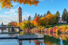 Autumn View With Leaves Turning Fall Colors Near The Clock Tower Along The Spokane River At Riverfront Park In Downtown Spokane, Washington, USA.
