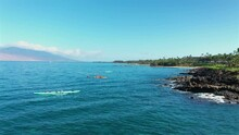 Tourist In Kayaks And Outrigger Canoes Off The Coast Of Wailea Maui, Hawaii