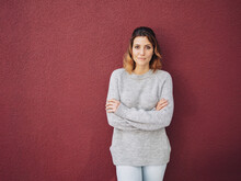 Confident Trendy Woman Standing Looking Pensively At Camera