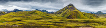 Beautiful Icelandic Landscape With Mountains, Sky And Clouds. Trekking In National Park Landmannalaugar