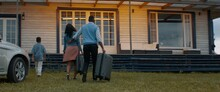 WIDE Happy African American Family Of Arriving By Car To Their New House
