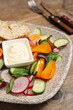 Leinwandbild Motiv Plate of delicious vegetable salad with mayonnaise and croutons on wooden table, closeup