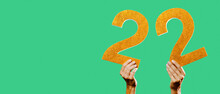 Holds Number 22 In His Hands, Web Banner