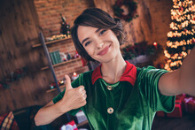 Photo Of Sweet Shiny Young Lady Wear Elf Clothes Showing Thumb Up Tacking Selfie Celebrating Christmas Smiling Indoors House Home Room