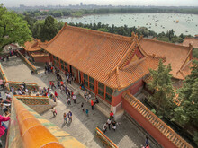 Chinese Archways, Pagodas, Temples And Palaces With Heaven Sky Clouds And Ornaments Landmarks Sightseeing In Beijing, Peking In China On Sunny Day With Red Columns And Doors Summer Palace