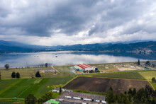 View From A Drone Of A Growing Area With A Factory And A Lake In The Background In The Town Of Sibate, Cundinamarca. Colombia.