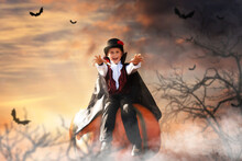 Boy Child In A Vampire Costume For Halloween Depicts Anger Sweetness Or Nasty Sits On A Pumpkin