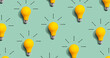 Leinwandbild Motiv Yellow light bulb pattern with shadow - flat lay