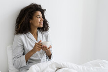 Young Afro American Woman With Cup Resting At Morning