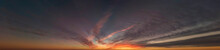 The Panorama Of Darkening Sky After Sunset With Dark Feathery, Cirrus-layered Clouds