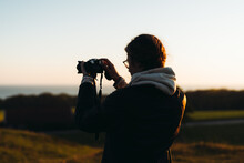 Photographer In The Sunset