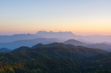 Aerial View Of Doi Chiang Dao Mountains In The Morning And The Sea Of Mist, Doi Kham Fa. Chiang Mai Province, Thailand. Pink Cherry Blossom.