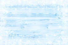 Abstract Winter Blue Wood Texture Planks With Snow Flakes Background.