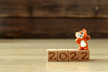 Miniature Tiger On Wooden Cubes With The Inscription 2022, New Year
