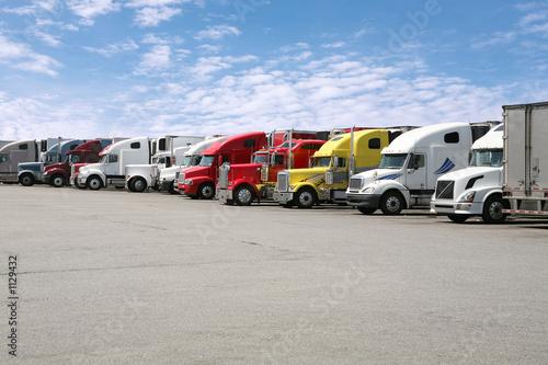 Wallpaper Mural semi trucks in line
