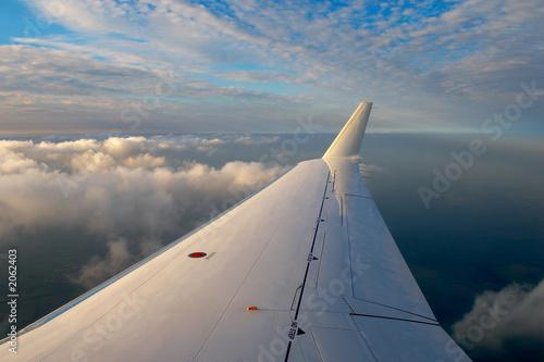 Fotografie, Tablou airplane wing in sunset