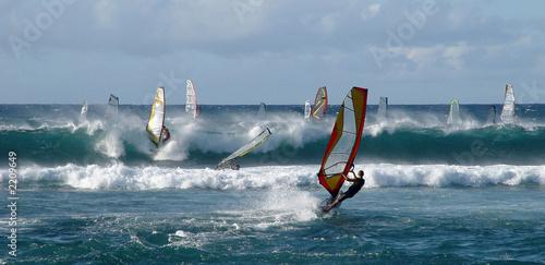 People windsurfing on high waves