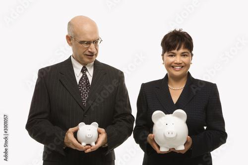 Slika na platnu businesspeople holding piggybanks.