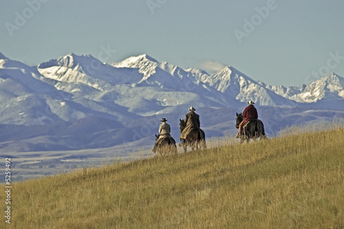 Cowboys on the range on a Montana horse ranch