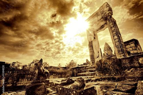 Fotografia Lone doorway standing in desolate temple ruins