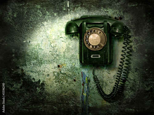 Old phone on the destroyed wall #5596240