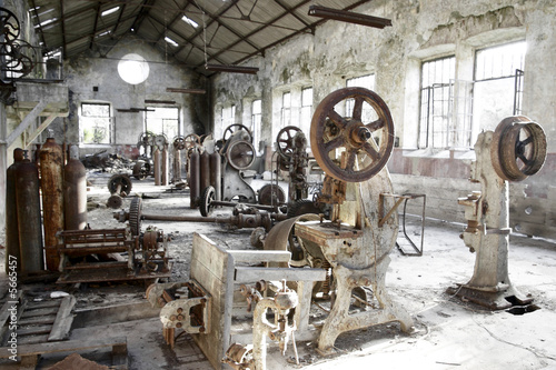 Old abandoned factory with useless rusty machinery.